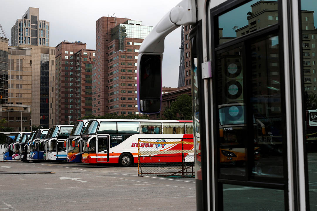 Tourist buses parked in a row at the parking lot in Taipei