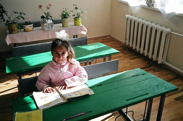 A girl in school.